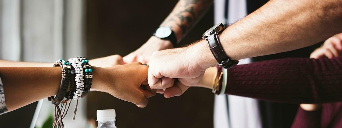 Team bracelets collaboration colleagues 398532